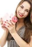 Cheerful young woman holding piggybank Royalty Free Stock Photo