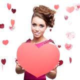 Cheerful young woman holding red paper heart Stock Photos