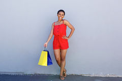Cheerful young woman holding shopping bags Stock Images