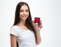 Cheerful young woman holding small gift box Royalty Free Stock Photos