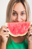 Cheerful Young Woman Holding Watermelon Royalty Free Stock Photos
