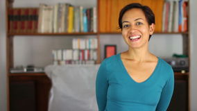 Cheerful young woman at home stock footage