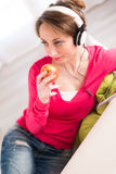 Cheerful young woman at home with tablet compuer Stock Photography