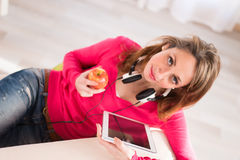 Cheerful young woman at home with tablet compuer Royalty Free Stock Photo