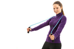 Cheerful young woman with jump rope over neck. Isolated Royalty Free Stock Images