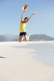 Cheerful young woman jumping at the seashore Royalty Free Stock Image