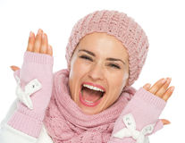 Cheerful young woman in knit winter clothing Royalty Free Stock Images