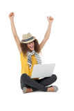 Cheerful young woman with laptop raising hands Stock Images