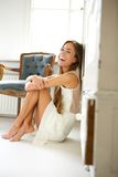 Cheerful young woman laughing at home Stock Image