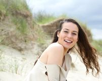 Cheerful young woman laughing outdoors Royalty Free Stock Photography