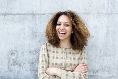Cheerful young woman laughing outdoors Stock Photos