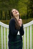 Cheerful young woman laughing outdoors in the park Royalty Free Stock Photography