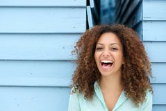 Cheerful young woman laughing outdoors Stock Images