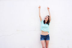 Cheerful young woman laughing and pointing finger up Royalty Free Stock Images