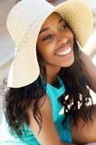 Cheerful young woman laughing with sun hat Royalty Free Stock Photos