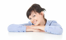 Cheerful young woman leaning on the table Stock Images