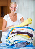 Cheerful young woman with linen Royalty Free Stock Images