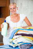 Cheerful young woman with linen Royalty Free Stock Photos