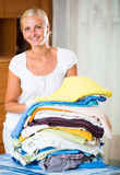 Cheerful young woman with linen Royalty Free Stock Photo