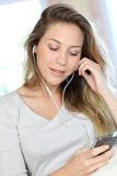 Cheerful young woman listening to music Royalty Free Stock Photo