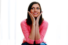 Cheerful young woman looking away. Isolated on a white background Royalty Free Stock Photo