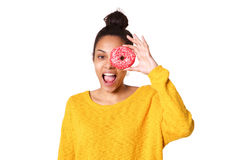 Cheerful young woman looking through a donut Royalty Free Stock Photography