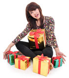 Cheerful young woman with lots of gifts Royalty Free Stock Photo