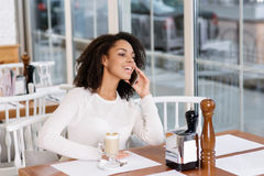 Cheerful young woman making phone call Royalty Free Stock Photography