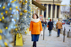 Cheerful young woman in Paris at Christmas Royalty Free Stock Image