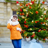 Cheerful young woman in Paris on a winter day Royalty Free Stock Photography