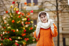 Cheerful young woman in Paris on a winter day Royalty Free Stock Image