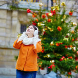 Cheerful young woman in Paris on a winter day Royalty Free Stock Photos