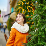 Cheerful young woman in Paris on a winter day Stock Photography