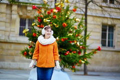 Cheerful young woman in Paris on a winter day Royalty Free Stock Photo