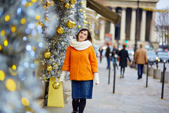 Cheerful young woman in Paris on a winter day Stock Images