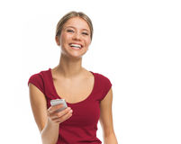 Cheerful young woman with phone Royalty Free Stock Photos