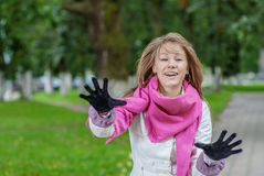 Cheerful young woman with pink scarf Stock Photo