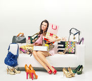 Cheerful young woman with plenty of shopping bags Royalty Free Stock Photos
