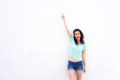 Cheerful young woman pointing finger up Stock Photography
