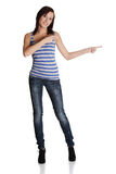 Cheerful young woman pointing on the right side. Royalty Free Stock Photography