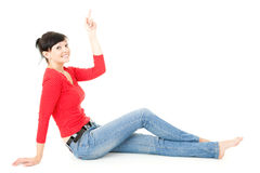 Cheerful young woman pointing up, full lenght Stock Photo