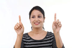 Cheerful young woman pointing on a virtual screen Stock Image