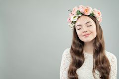 Cheerful Young Woman Portrait. Pretty Model Girl with Natural Makeup and Flowers stock image