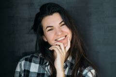 Cheerful young brunette smiling inquisitive lady royalty free stock images