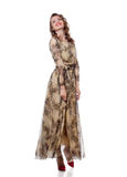 Cheerful young woman posing in stylish long dress Royalty Free Stock Photo