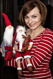 Cheerful young woman posing with two santas, Christmas scene Royalty Free Stock Photo