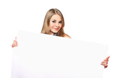 Cheerful young woman posing with white board Royalty Free Stock Photos