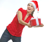 Cheerful young woman presenting Christmas gift box Stock Photos