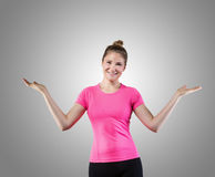 Cheerful young woman with raised arms juggling royalty free stock photography