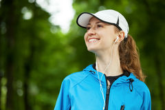 Cheerful young woman ready to start her morning workout. Royalty Free Stock Image
